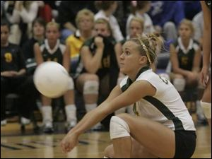 Clay s Kaitlyn Crawford is the picture of concentration as she digs one out against Elyria last night in Norwalk.