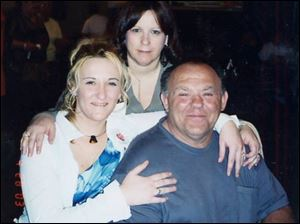 The late James Briscoe is shown with his daughter, Cheryl Kennedy, left, and his wife, Cynthia Briscoe.