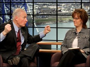 Carty Finkbeiner talks to Allison Perz during a taping of  Carty & Co.  at WTVG-TV, Channel 13. The public affairs show aired Sunday mornings. Mayor Jack Ford never appeared on the show.