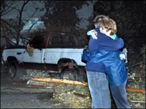 Steve Auten hugs his mother, Shelly, after a tornado swept through Newburgh, Ind., early today.