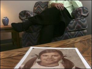 Sister Ann-Marie Borgess, with childhood photo in foreground, says the proposed bill will expose abusive clerics.