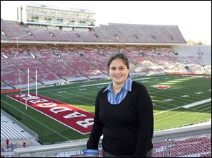 Defiance native Katharine Palmer, who formerly worked with the football program at Ohio State, is impressed with Wisconsin's Ca