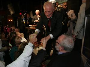 A victorious Carty Finkbeiner accepts congratulations from well-wishers.