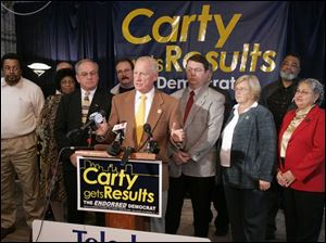 Mayor-elect Carty Finkbeiner introduces his transition team at his campaign headquarters.
