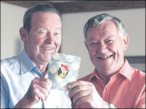 Harold C. Ackerman, left, and Ernie Bollinger hold the birthday card that they have been