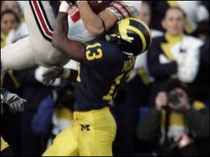 Ohio State wide receiver Anthony Gonzalez goes high against Michigan defensive back Grant Mason to come up with a vital reception to set up the winning touchdown for the Buckeyes late in the fourth quarter.