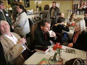 Sherrod Brown has a cup of coffee yesterday as he talks with voters during a stop at Toledo's Downtown Latte to kick off his campaign for U.S. Senate. Schuyler Beckwith, right, and Al Baldwin share a table with the candidate.
