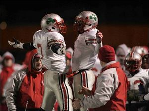Chris Willis, left, and Neil Mitchell celebrate during the fourth quarter of Friday's state championship game. Willis and Mitchell shared the tailback job after Willis was slowed by an injury.