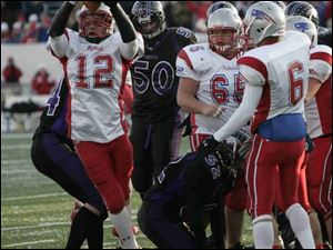 Patrick Henry's Tom Busch celebrates after recovering a Cincinnati Hills Christian Academy fumble on Friday.