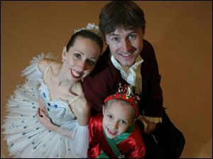 Performing in this year's production of <i>The Nutcracker</i> are Nik Zisk, his wife, Heather Iler, and their daughter, Madison, 7.