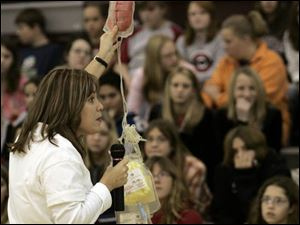 Terri Shinn fills in seventh graders at John C. Roberts Middle School on the details of blood donation. Most students were relieved to be asked to recruit donors, not become ones.