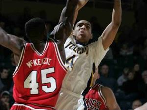 Toledo's Jonathan Amos goes up for a shot against Northern Illinois defender Bryson McKenzie in the first half.