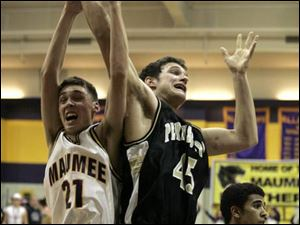 Maumee's Corey Nelson and Perrysburg's Glen Empie battle for a rebound. Empie had seven points and seven rebounds as the Yellow Jackets picked up a key Northern Lakes League win.