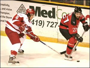 The Storm's Bracken Kearns, left, chases Las Vegas' Darren Lynch ... and the puck.