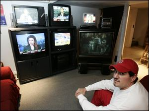 "Steve Ramirez sits in front of his ""TV cove."""