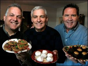 Joe Pasquinelli, left, Dave Kaminski, and host Lad Norris, friends who grew up together, show off the cookies and candy each made for their annual cookie party.