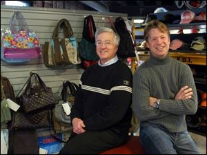 Kent, left, and Shawn Rogers have expanded their company's merchandise from hats and caps to bags, jewelry, footwear, and belts.