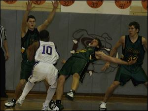 Clay's Brent Graham goes sprawling trying to guard Waite's Troy Murphy (10) as Andy Knopp and Dan Bachmayer help.