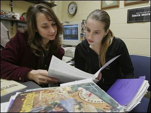 Woodward High School counselor Sarah Barman examines an honors application with senior Kateryna Gololobova.