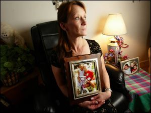 Nadine Fechtner holds a picture of her late daughter, Buffie Rae Brawley, and Ms. Brawley's daughter, Ebony.
