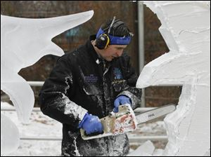 Ice sculptor Chad Hartson helps kick off the sixth annual Frozentoesen with a demonstration of his skill with the chain saw.