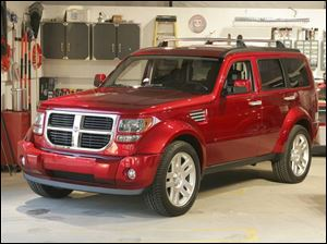 Tom LaSorda, president and CEO of Chrysler, says the Dodge Nitro, to be produced in Toledo, is 'going to be a big hit. It's going to be a great, great vehicle.'