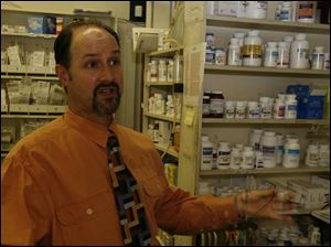 Michael Calabrese, pharmacist and own