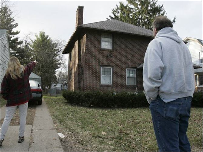 Captive teenage cousins suffer crash course in forced sex trade The mother of 'Stacy' points to the house where her daughter and niece 'Cara' were held, while Cara's father looks on.