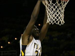 Toledo's Ridley Johnson goes airborne for a dunk against Eastern Michig