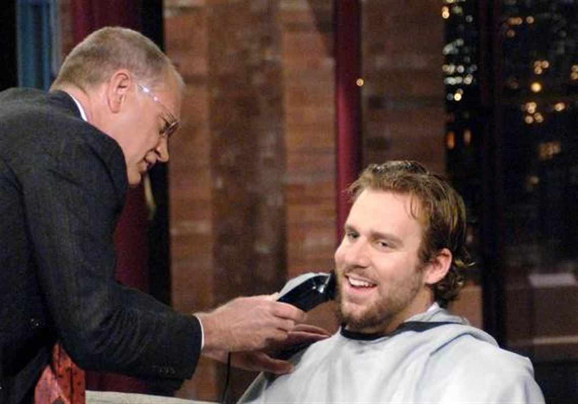 Pittsburgh Steelers quarterback Ben Roethlisberger has his beard trimmed by the host on Late Show with David Letterman.