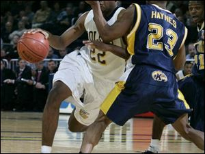 Toledo's Keonta Howell is fouled by Kent State's DeAndre Haynes as he drives to the basket in the second half. Howell had nine points. He was 2-for-2 from 2-point range and 5-for-5 from the free-throw line, but was 0-for-2 from beyond the 3-point arc.