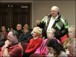 Jim Cook, owner of Jim's Snowmobile Sales, speaks against a proposed 0.5 percent county sales tax during a Henry County commissioners' public hearing in Napoleon.