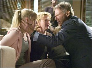 Jack (Harrison Ford) reassures his family (from left, Carly Schroeder,