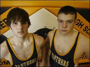 Tim Samson, left, was Whitmer's heavyweight at 235 pounds. Now he's competing at 171. Ryan Ernst is the current Panthers heavyweight at 240.