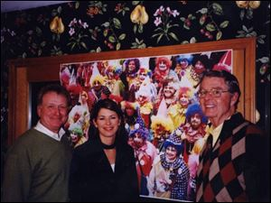 SEND IN THE CLOWNS: From left, Jim Murray, Wendy Gramza, and Bob Savage enjoy the festivities.