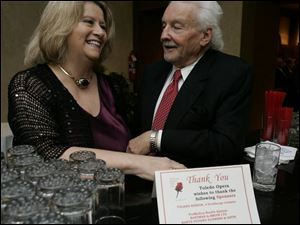IN KEY: Ann Sanford and Bernie Leiter chitchat during the Toledo Club event for the opera gala.