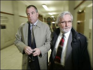 Coin dealer and GOP fund-raiser Tom Noe, left, arrives at the Lucas County Courthouse with attorney Jon Richardson.