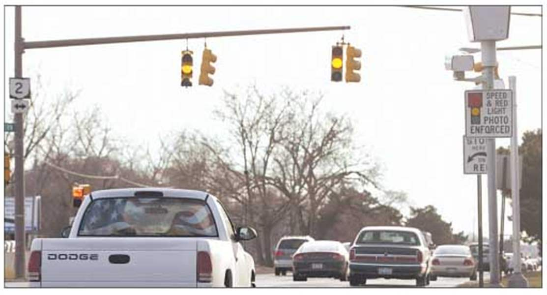 Plastic Covers, License Plate Sprays Latest Tools To Thwart Red Light  Photos   The Blade