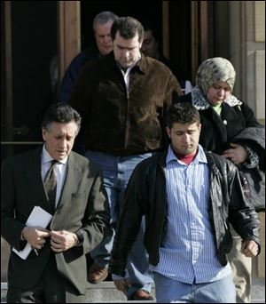 Attorney Charles Sallah escorts family members of Wassim Mazloum from the federal courthouse yesterday.