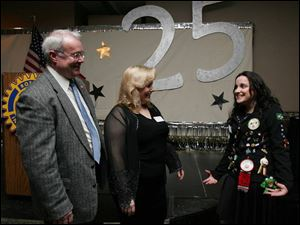 25-PLUS: Bob Adams, left, and Julie Oswald chat with Isa Freitas, a Brazilian exchange student.