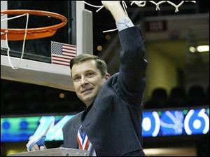 Bowling Green coach Curt Miller cuts down the net after his Falcons captured the MAC Tournament title, the eighth in school history, which is the most in the conference. Miller was recently named MAC coach of the year for the second straight season.
