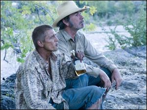 Barry Pepper and Tommy Lee Jones in <i>The Three Burials of Melquiades Estrada</i>.