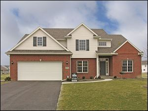 The home at 4734 Middle Branch is offered at $309,900 by Tarsha Building Company, Inc.