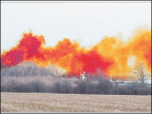 A chemical reaction at a hazardous waste facility in Vickery, Ohio, forms a toxic cloud of nitrogen dioxide.