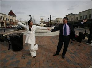 Chelsea Dillin dances with her father, Larry Dillin, at Levis Commons in Perrysburg. They will dance to 'Unforgettable' at her wedding reception.