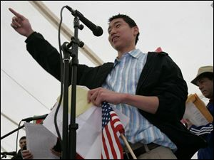 Andrew Jung, a 15-year-old freshman at Emmanuel Baptist High School whose parents were deported to South Korea, shared the story of his family at the FLOC rally yesterday.