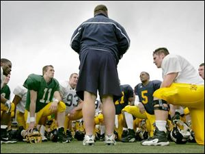University of Toledo coach Tom Amstutz speaks to his players after the scrimmage at the Glass Bowl.