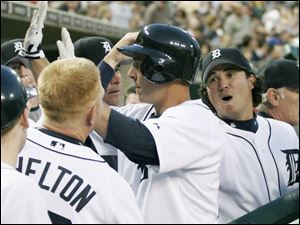 Brandon Inge, middle, is congratulated by his teammates after one of his two home runs during a victory over Cleveland.