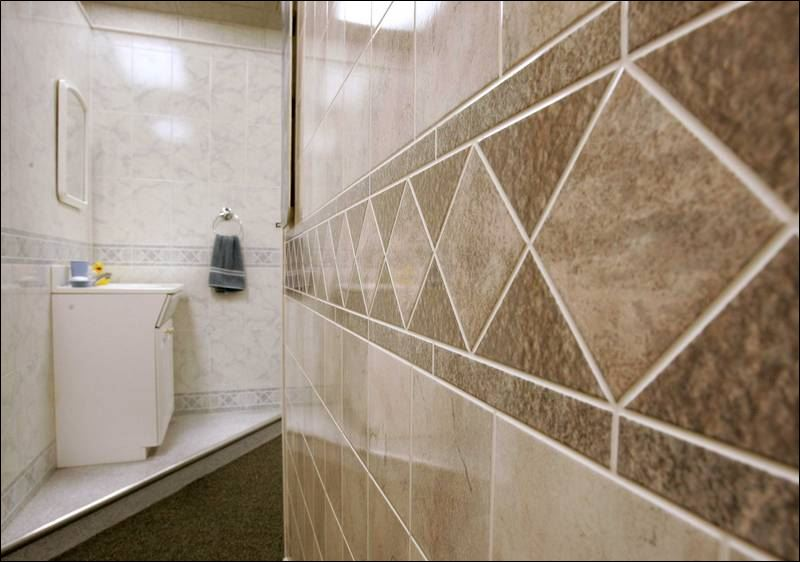 Panel conversion threatened firm transformed into toledo success toledo blade for Decorative bathroom wall tile