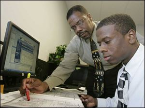 Casey Diggins, left, trains his son, Casey, Jr., to be an appraiser.